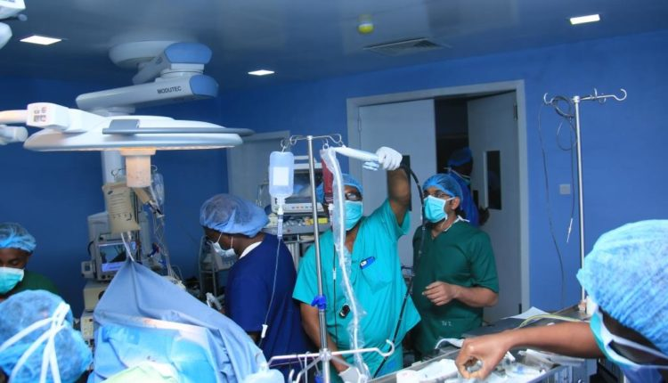 BUTH PERFORMS SPINAL CORD SURGERY ON 65 YEAR OLD